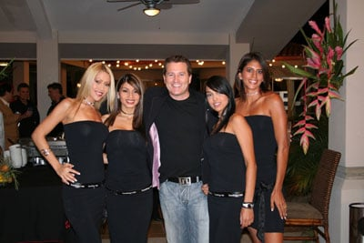 Shot of Bodog chief Calvin Ayre with four ladies