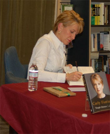 Fiorina signs copies of her book at a Mountain View bookstore