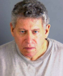 Police mugshot of Gad Zamir wearing gray t-shirt