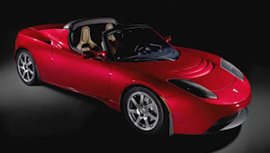 promo shot of red Tesla Roadster