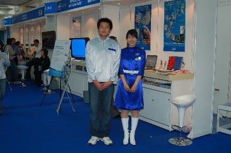 Man and women at IDF with Intel logos on