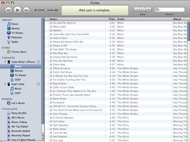 Screenshot of iTunes with library showing contents of iPhone music as gray