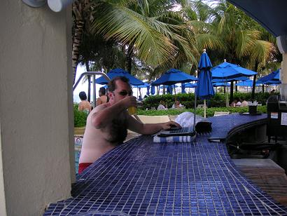 Shot of Hansen drinking on the job at poolside bar
