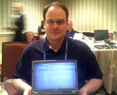 Picture of Rob Graham with notebook computer sitting on his lap