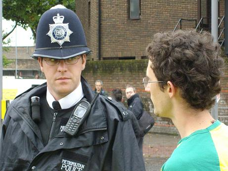 A policeman talks to an open source campaigner at the iplayer protest