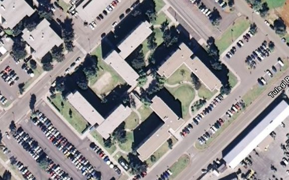 The swastika-shaped building as seen old Google Earth