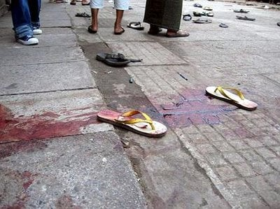 A picture of blood-stained sandals on the streets of burma today