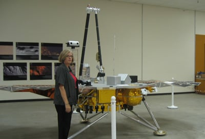A copy of the Phoenix lander, alongside Sara Howlands. Credit: Wendy M. Grossman