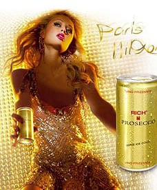 Paris hilton seen with can of Rich Prosecco in billboard ad