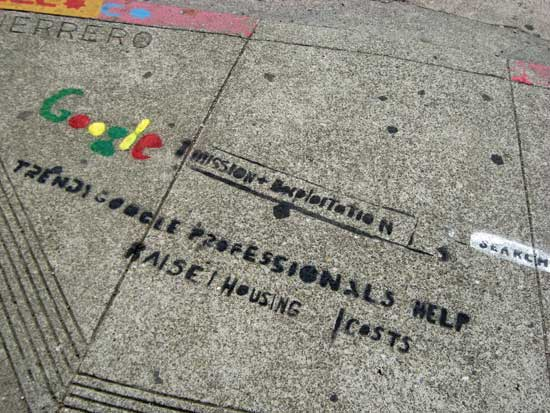 "Stencil that says ""Trendy Google professionals help raise housing costs."""