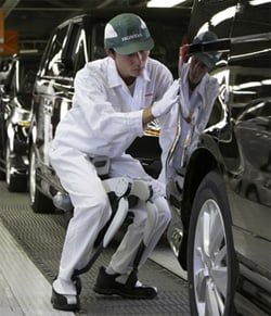 A Honda car worker tries out the walkermech