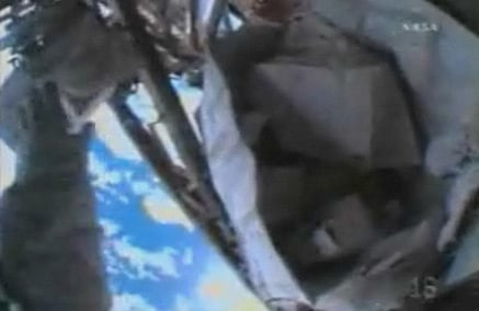 The toolbag at the moment of its escape. Pic: NASA TV