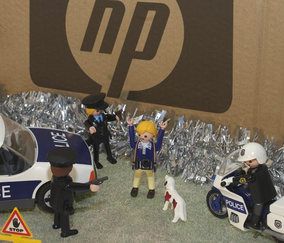 Police tackle photographer at foot of enormous HP box