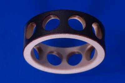 A plastic bearing cage, coated in artificial diamond by the