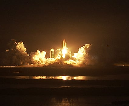 Discovery blasts off en route to the ISS.