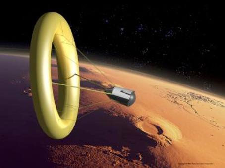 "Global Aerospace concept of ""lifting-towed-toroidal-ballute"". Background: Tharsis Ridge, Mars."