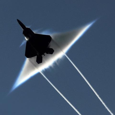 An F-22 Raptor carries out a supersonic flyby
