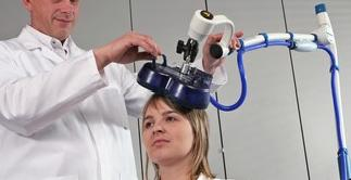 A subject undergoing magnetic brain stimulation