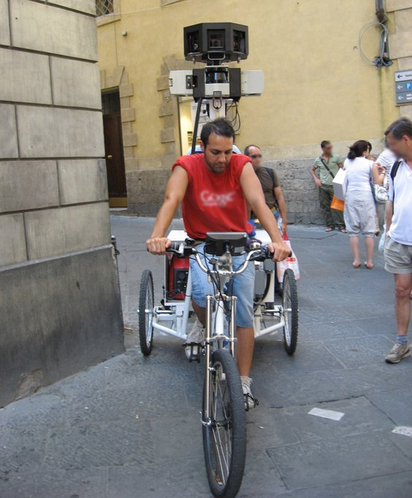 Street View operative demonstrating his snooptrike technique