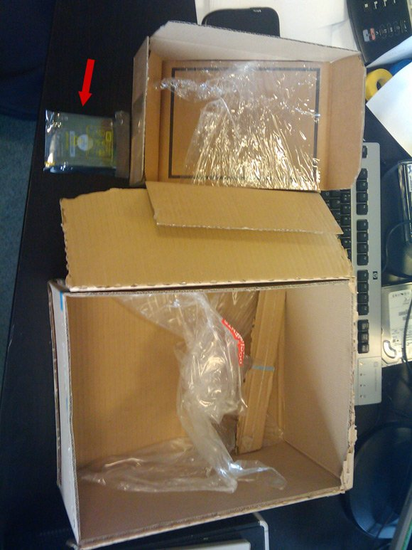 Two very large boxes containing one small drive