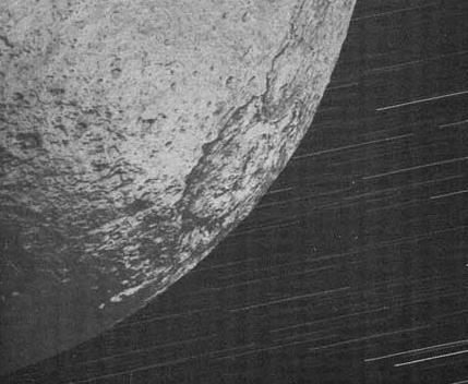 Long-exposure shot of Iapetus, moon of Saturn, taken by the Cassini probe. Credit: NASA