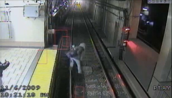 CCTV view of woman falling onto train tracks