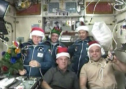 The Expedition 22 crew pose in festive ha