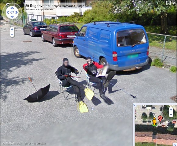 Two men dressed as frogmen sitting on Bergen street