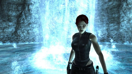 Lara Croft in front of pool and waterfall inside cavern