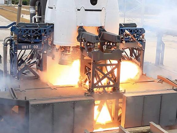 The Falcon 9 spits fire briefly during an aborted static test. Credit: SpaceX