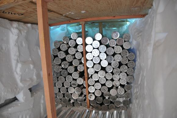 Ice cores stored in a snow trough at the Bruce Plateau camp. Credit: Ellen Mosley-Thomp