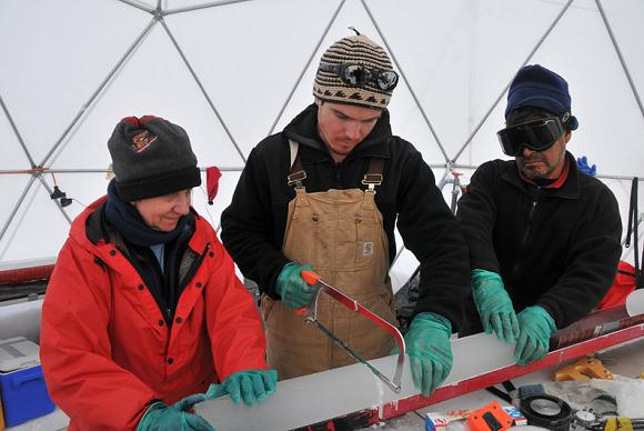 Ellen Mosley-Thompson and colleagues saw up ice cores at the Bruce Plateau camp. Credit: Ellen Mosley-Thompson, OSU
