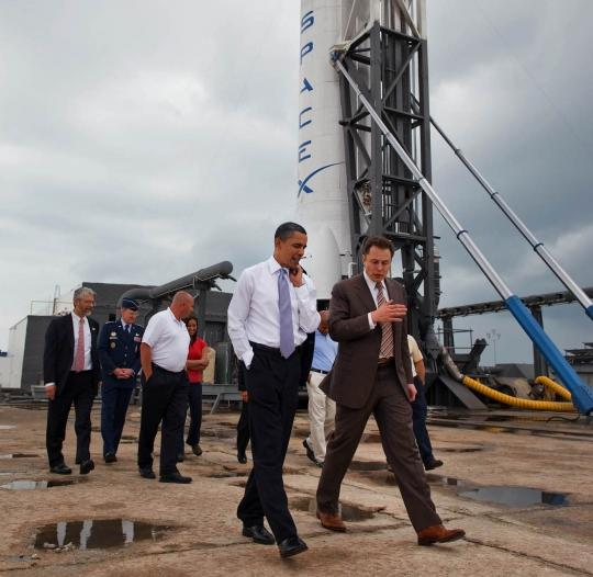 Elon Musk bends the President's ear at Cape Canaveral. Credit: The White House