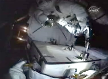 Spacewalker bolts battery to Integrated Cargo Carrier. Pic: NASA TV