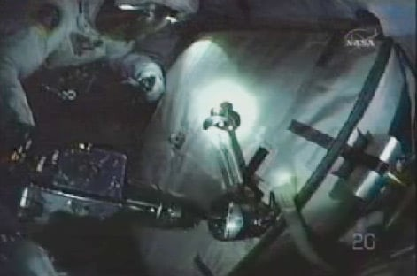 Spacewalkers bolt old battery to Integrated Cargo Carrier. Pic: NASA TV