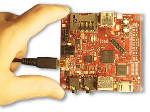 hand holding Beagleboard between two fingers