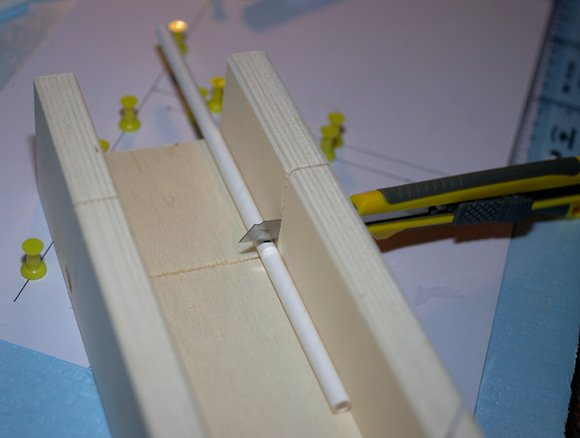 Cutting a straw with a mitre block and knife