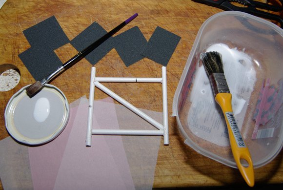 Skinning kit, with tissue paper, glue, and test structure frame