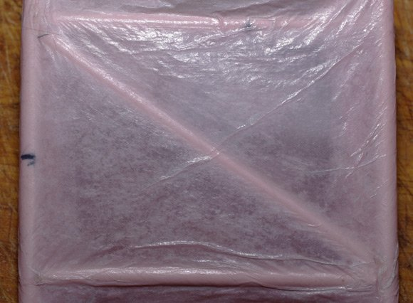 Three layers of tissue paper treated with an extra coat of PVA