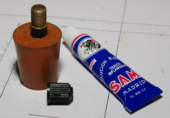 Bicycle valve glued into rubber bung