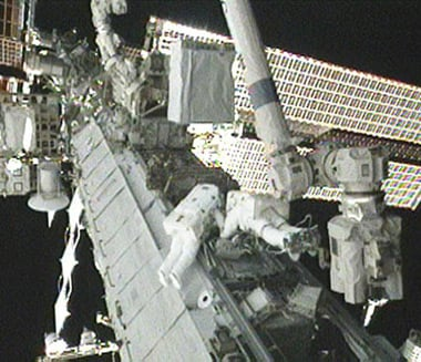 Tracy Caldwell Dyson (left) and Doug Wheelock during today's spacewalk. Pic: NASA TV