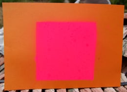 The target - A4 sheet of orange card marked with pink fluorescent paint