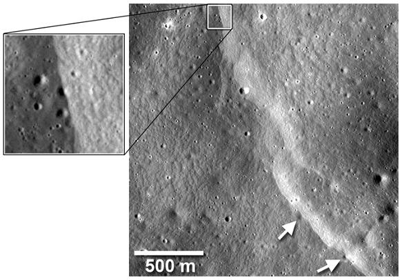 NASA LRO image showing lobate scarp cutting across small craters. Credit: NASA Goddard/Arizona State University/Smithsonian