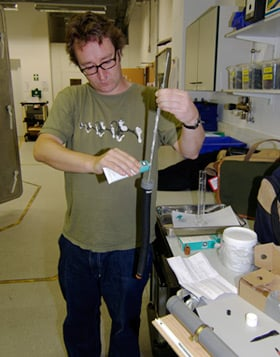 John Oates greases the release mechanism