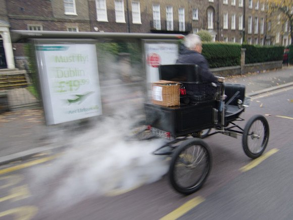 We pass a steam car in South London