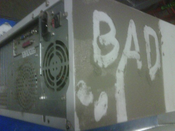 BAD written in thick dust on PC case