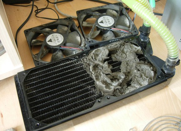 Water cooling unit halfway through a much-needed dust-off