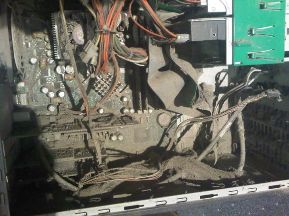 The PC's interior, caked in dust