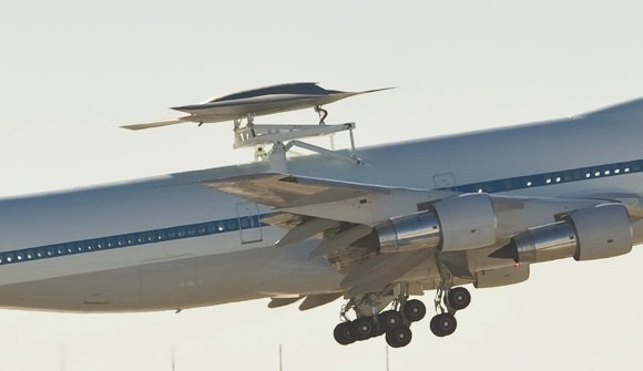 The Phantom Ray UAS piggybacked on NASA's Shuttle transporter 747. Credit: Boeing