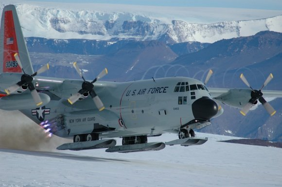 A US C-130 Hercules equipped with skis takes off in the Antarctic using JATO. Credit: DoD
